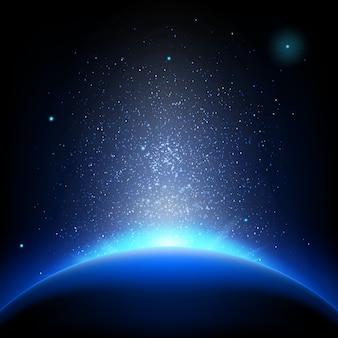Ziemia - wschód słońca w ciemnoniebieskiej przestrzeni.