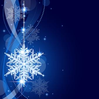 Zima bożenarodzeniowy tło z wiszącym płatkiem śniegu