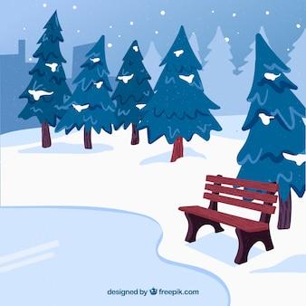 Zima krajobraz z ławką przy jeziorem
