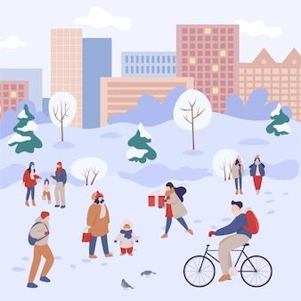 Zimą ludzie spędzają czas prześcigając się. ludzie w ciepłych ubraniach