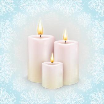 Zima w tle, trzy płonące świece, wzór płatka śniegu