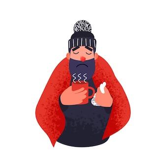 Zimny mężczyzna w dywaniku trzyma kubek