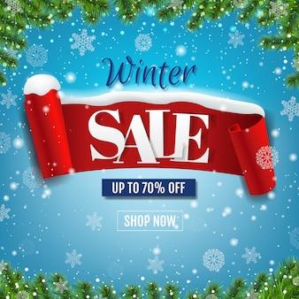 Zimowa wyprzedaż niebieski transparent z czerwoną wstążką i śniegiem