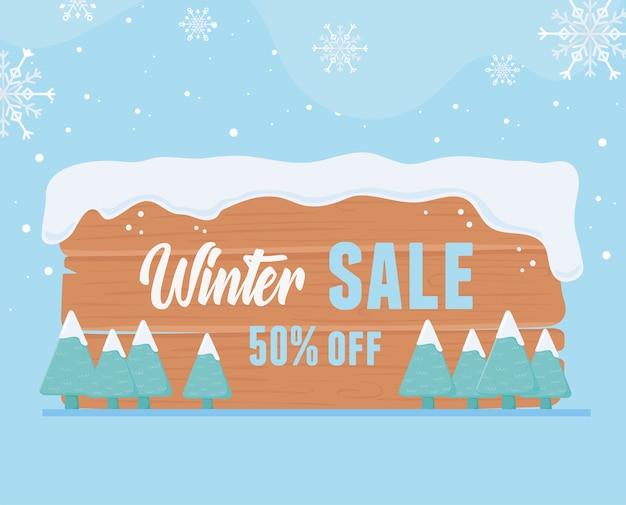 Zimowa wyprzedaż oferuje drewniany baner marketingowy ze śniegiem