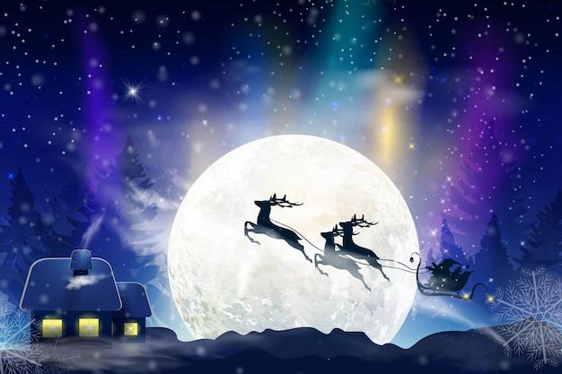 Zimowe błękitne niebo z padającym śniegiem, płatki śniegu z zimowym krajobrazem przy pełni księżyca. święty mikołaj lecący na saniach z jeleniem. świąteczne tło zima na boże narodzenie i nowy rok.