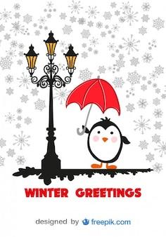 Zimowe karty z życzeniami kreskówki pingwina z czerwonym parasolem