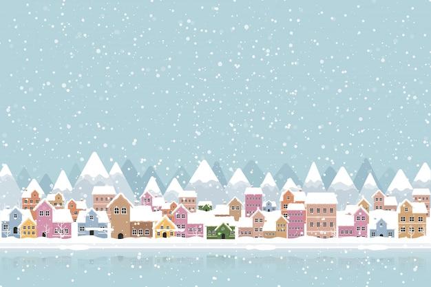 Zimowe miasto płaski styl z padającego śniegu i góry