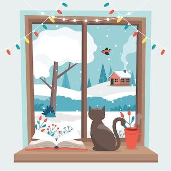 Zimowe okno z kotem, książką i filiżanką kawy na parapecie.