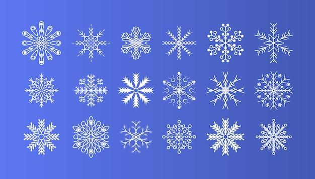 Zimowe płatki śniegu kryształowy element. dekoracja świąteczna. zimowy zestaw białe płatki śniegu na białym tle na tle. fajny element na świąteczny baner, pocztówki.