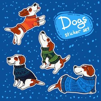Zimowe stikery z psami w kolorowych swetrach