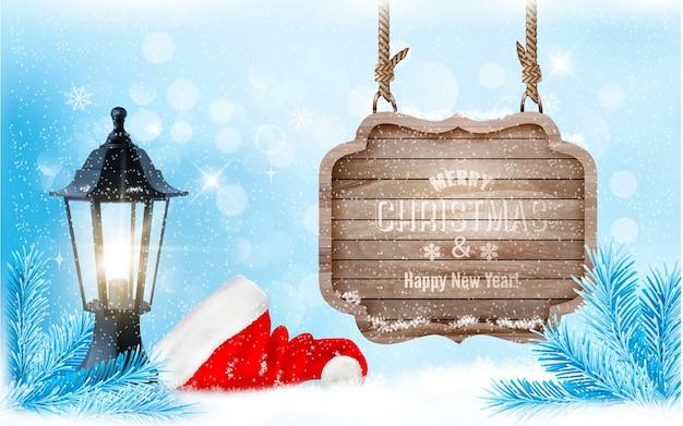 Zimowe święta ze znakiem, latarnią i tłem w postaci czapki mikołaja.