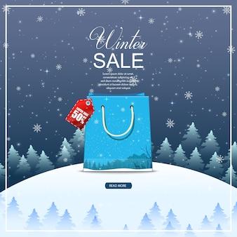 Zimowe tło sprzedaż z niebieską torbą