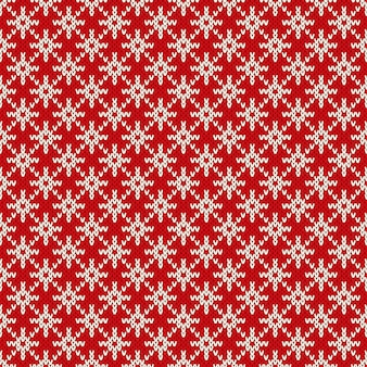 Zimowe wakacje bez szwu dzianiny wzór z płatki śniegu. świąteczny sweter na drutach. wełna dzianinowa tekstura