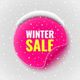 Zimowy baner sprzedaży. różowa okrągła naklejka ze śniegiem. ilustracja.