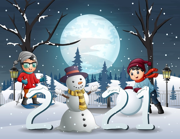 Zimowy krajobraz nocny tło z szczęśliwymi dziećmi