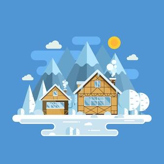 Zimowy krajobraz wioski ze śnieżnymi domami, zamarzniętym jeziorem i szczytami górskimi.
