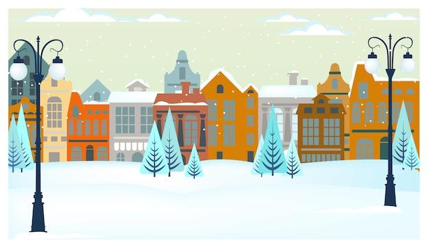 Zimowy krajobraz z domkami, drzewami i latarniami ulicznymi