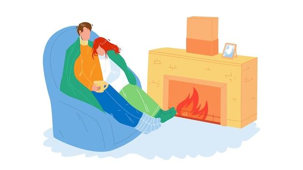 Zimowy odpoczynek para razem w pobliżu kominka wektor. młody mężczyzna i kobieta owinięta w kratę, relaks na fotelu i picie gorącego napoju, rodzinny odpoczynek zimowy. postacie odpoczynek ilustracja kreskówka płaskie