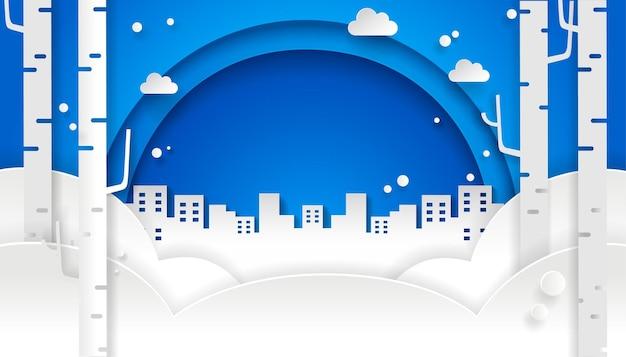 Zimowy papierowy projekt z niebieskim niebem i miastem. śnieg w tle.