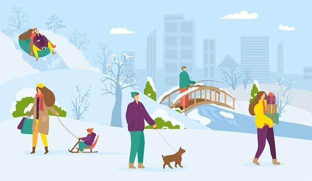 Zimowy park miejski z chodzącymi ludźmi