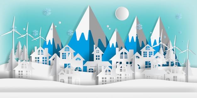 Zimowy pejzaż z budynkami wyciętymi z papieru