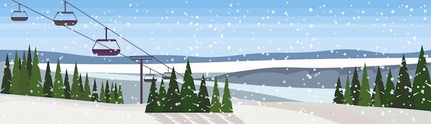 Zimowy pejzaż z transparentem kolejki linowej