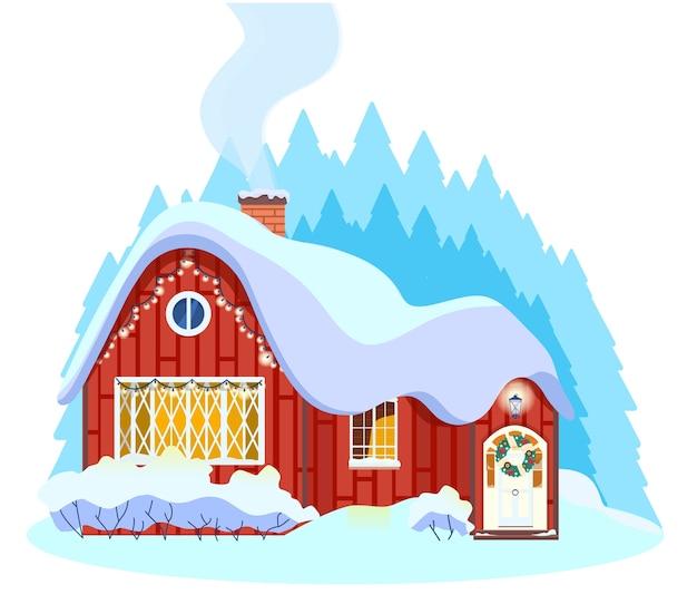 Zimowy wiejski domek ozdobiony wieńcem