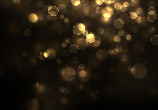 Złocisty bokeh zamazany światło na czarnym tle. złote światła i szablon wakacje nowy rok. streszczenie brokat nieostre migające gwiazdy i iskry.