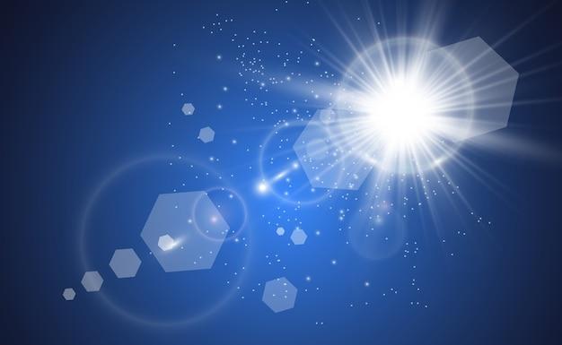 Złota jasna gwiazda. efekt świetlny jasna gwiazda. piękne światło do zilustrowania. gwiazda bożonarodzeniowa białe iskry błyszczą specjalnym światłem. błyszczy na przezroczystym tle.