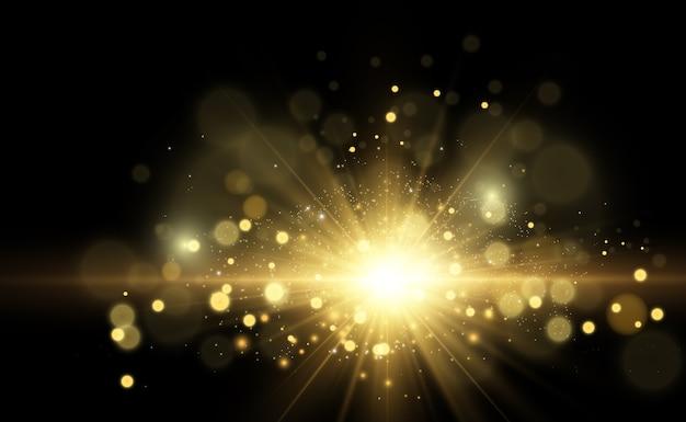 Złota jasna gwiazda. efekt świetlny jasna gwiazda. piękne światło do zilustrowania. star białe iskry błyszczą specjalnym światłem. błyszczy na przezroczystym tle.