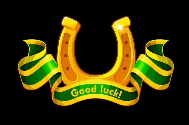 Złota podkowa z zieloną wstążką z napisem powodzenia