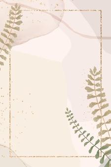 Złota prostokątna ramka w kształcie liścia na pastelowym brązie