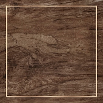Złota rama na drewnianym tle