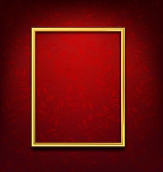 Złota rama vintage na czerwonej ścianie
