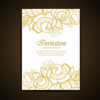 Złota ręka rysująca kwiecista i liść zaproszenie karta