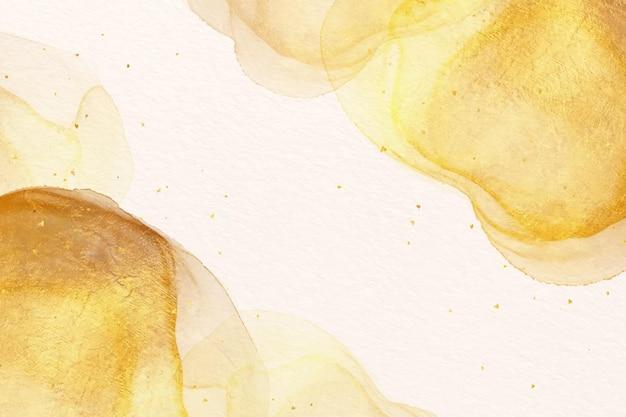 Złota tapeta z farbą akwarelową