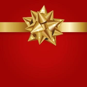 Złota wstążka dekoracji na czerwonym papierze prezent prezent do świętowania