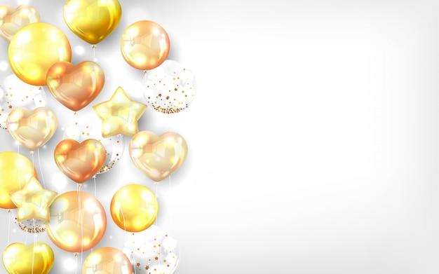 Złote balony na białym tle