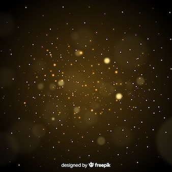 Złote cząsteczki rozmazane tło dekoracyjne