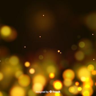 Złote cząsteczki tło w stylu bokeh