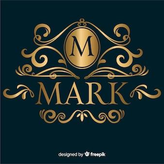 Złote eleganckie ozdobne logo