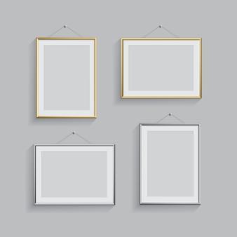 Złote i srebrne prostokątne ramki na zdjęcia lub zdjęcia w różnych pozycjach na szarym tle.