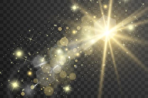 Złote iskry błyszczą specjalnym efektem świetlnym. błyszczy na przezroczystym tle. lśniące, magiczne cząsteczki kurzu