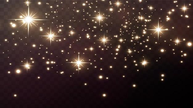 Złote iskry i złote gwiazdy błyszczą z prawdziwym efektem świetlnym. eksplozja złotych konfetti.