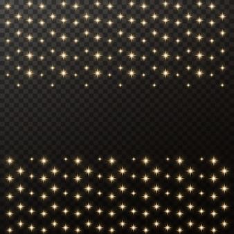 Złote iskry i złote gwiazdy błyszczą ze specjalnym efektem świetlnym.