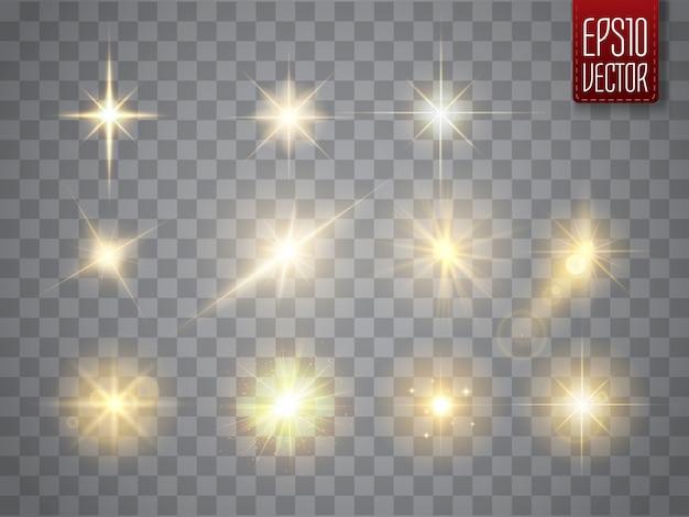 Złote iskry na białym tle. wektor świecące gwiazdy. flary i błyski obiektywu