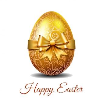 Złote jajko wielkanocne przewiązane złotą wstążką