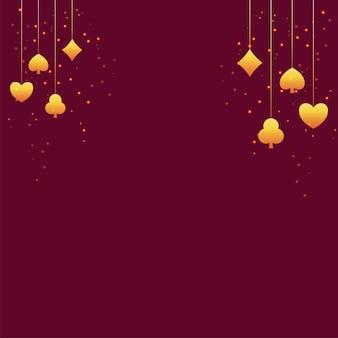 Złote karty garnitury powiesić i efekt światła na czerwonym tle z miejsca kopiowania.