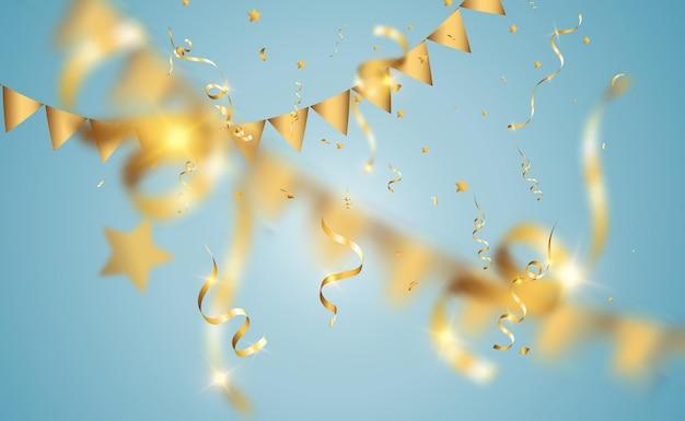 Złote konfetti. spadające serpentyny na scenie.