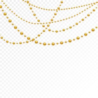 Złote koraliki na białym tle.